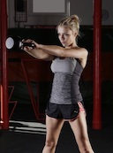 Woman doing kettle bell swings